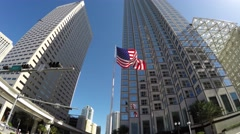American Waving Flag in Miami, Florida, Outer Loop Metromover train - stock footage