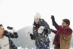 Couple enjoying snowball fight Kuvituskuvat