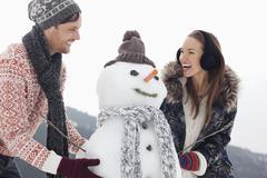Happy couple making snowman Stock Photos