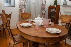 Dining table set for four - stock photo