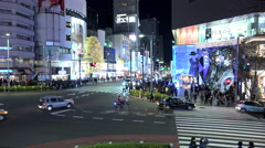 Holiday traffic and shoppers at a busy intersection in Omotesando - stock footage