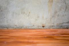 Cement wall and wood floor Stock Photos