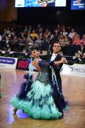 Ballroom dance couple, dancing at the competition - stock photo