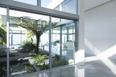 Plants growing in modern courtyard Stock Photos