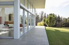Modern building overlooking manicured lawn Stock Photos
