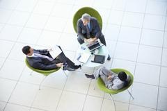 High angle view of business people meeting in lobby Stock Photos