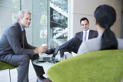 Business people meeting in lobby Stock Photos