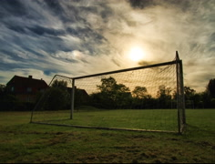 Sunset Through Soccer Goal Post in 4K and HD Stock Footage