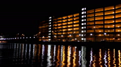 City lights reflections on the water Stock Footage