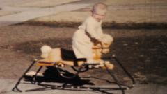 Little Boy Going Crazy On His Rocking Horse-1964 Vintage 8mm film Stock Footage