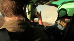 POV from backseat of a helicopter. Camera pan from an over the shoulder shot of - stock footage