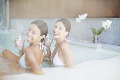 Portrait of smiling women in spa pool Kuvituskuvat