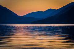 Distant mountains and Lake Crescent at sunset, in Olympic National Park, Wash Stock Photos