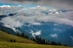 Hillside and mountains obscured by clouds, seen from Hurricane Ridge, in Olym - stock photo