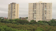 Establishing shot of two apartment buildings in Durban, South Africa. Wide-shot Stock Footage