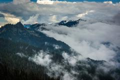 View of mountains and low clouds from Hurricane Ridge, in Olympic National Pa - stock photo