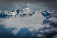 View of the snowy Olympic Mountains and low clouds from Hurricane Ridge, in O Stock Photos