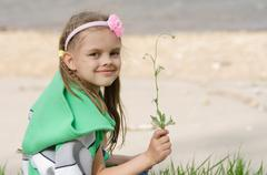 Stock Photo of Girl with blade of grass in hands