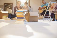 Friends relaxing together in new attic Stock Photos
