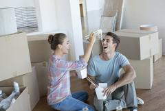 Stock Photo of Couple eating Chinese take out food in new house
