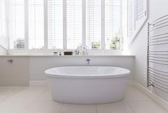 Bathtub in modern bathroom Stock Photos