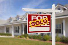 For Sale Sold Real Estate Sign and New House. Stock Photos