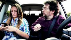 Father and daughter fighting in car for phone addiction Stock Footage
