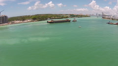Barge towed into port aerial view Stock Footage