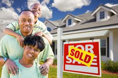 African American Family with Sold For Sale Sign and House Stock Photos