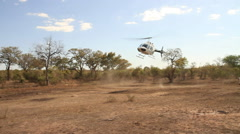 Helicopter landing in a wilderness area of the Kruger National Park - stock footage