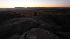 Hiker Walking in the Mountains at Sunrise - stock footage