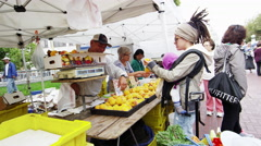 Buying fruit at an open market Stock Footage