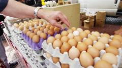 Fresh eggs in an open market Stock Footage