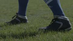 Cleats in Grass Stock Footage