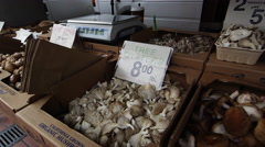 Fresh mushrooms at open market in San Francisco - stock footage