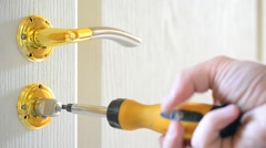 Mounting a mortise door lock. Fastening screws of door handles Stock Footage