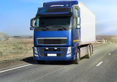 Truck on country highway Stock Photos