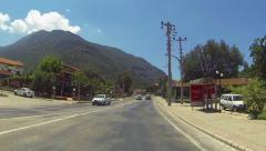 Car traveling downhill on curved mountain roads. Mount Babadag, Fethiye Turkey Stock Footage