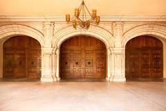 Three Majestic Classic Arched Doors with Chandelier. Stock Photos