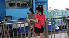 People sit in the booth ride a roller coaster in the Ocean Park Hong Kong Stock Footage