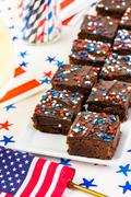 Variety of desserts on the table for July 4th party - stock photo