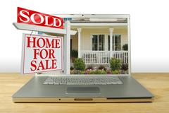 Sold Home For Sale Sign on Laptop Stock Photos
