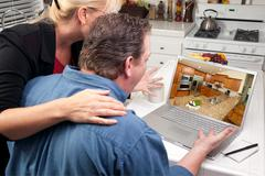 Couple In Kitchen Using Laptop - Home Improvement Kuvituskuvat