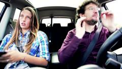 Female teenager annoyed by father driving car funny Stock Footage