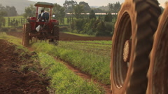 Two Tractors driving past Fields Stock Footage