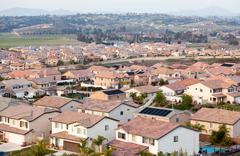 Contemporary Neighborhood Houses Roof Tops and Horizon View. - stock photo