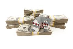 Small House with Stacks of Hundred Dollar Bills Isolated on a White Backgroun - stock photo