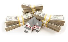 Stacks of One Hundred Dollar Bills with Small House. Stock Photos
