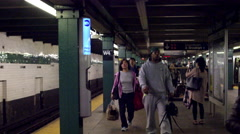 West 4th Street subway train station platform people walking slow motion 4K NYC Stock Footage