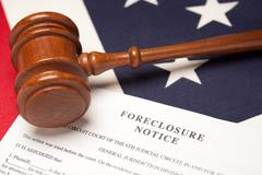 Gavel, American Flag and Foreclosure Notice with Selective Focus. Stock Photos